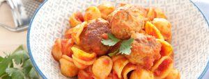 Meatballs on pasta with tomato sauce