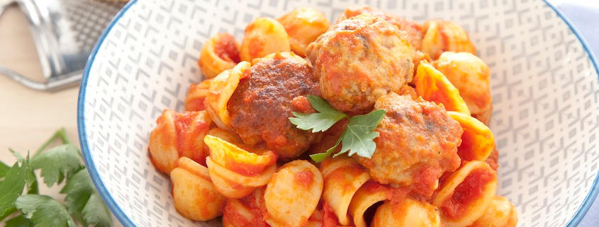 Meatballs on pasta with tomato sauce